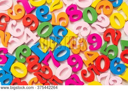 Colorful Wooden Colorful Numbers Background.top View Abstraction Of Multicolor Numbers From Zero To
