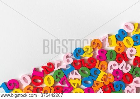 Colorful Wooden Numbers On Part Of Background With Copy Space. Numbers Texture Abstraction On Part O