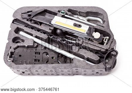 Spare Wheel Replacement Kit On A White Background In A Photo Studio With A Jack And A Wrench For Car