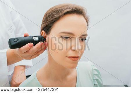 Female Patient Receives Ear Examinations. Video Otoscopy Procedure, Closeup. Hearing Clinic