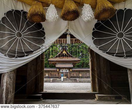Man Standing In The Kumano Hongu Taisha, One Of The Three Grand Shrines Of Kumano In Traditional Shi
