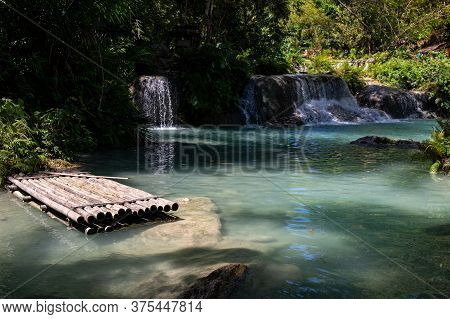Bamboo Raft In Lake. Tropical Nature Landscape With Waterfall River And Forest. Jungle Lake With Wat