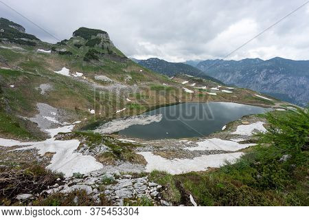 Lake In The Austrian Alps With Last Snow. Augstsee. Loser. Austria