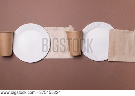 Infinity Line Of Eco-friendly Kitchen Ware On Brown Colored Papet Background. Top View. Close-up. Re