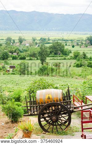 Nyaungshwe, Myanmar - 8 Jun 2014: Landscape Of The Inle Lake Valley, With A Local Wine Cask On A Car