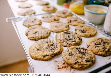 Close-up Of Ready-made American Cookies With Chocolate Crumbs On The Baking Lot With Paper.