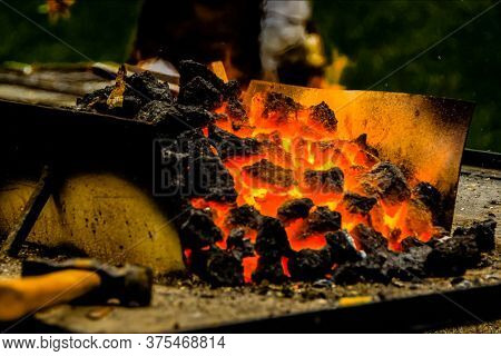 Hot Ore In A Steel Trough. A Metal Smelting Plant.