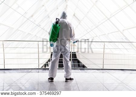 Disinfector Clean Surfeces Space In Modern Office To Prevent Corona Virus.