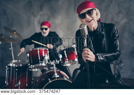 Photo Of Retired Lady Man Rock Popular Band Group Perform Concert Play Drum Instruments Sing Cool Mi