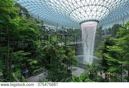 Singapore-30 Aug 2019: Jewel Changi Airport Is A New Terminal Building  Under A Glass Dome, With Ind