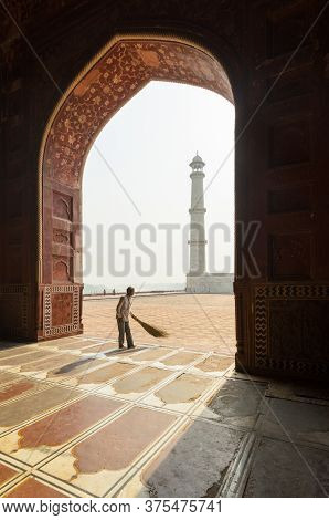 Agra, India - 5 May 2015: A Man Sweeps The Prayer Room In The Taj Mahal Main Mosque Before The Frida