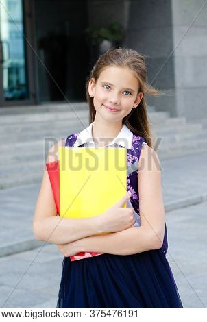 Back To School. Education Concept. Cute Smiling Schoolgirl On The Way To The School. Happy Little Gi