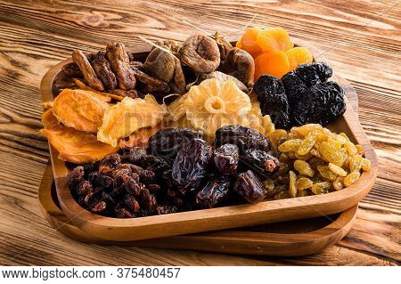 Mix Of Dried Fruits Symbols Of Judaic Holiday Tu Bishvat. Assorted Dried Fruits In Wooden Bowl. Orga
