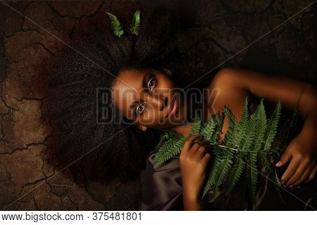 Conceptual Art Portrait Of A Young Black Woman Symbolizing  Earth On A Dark Background