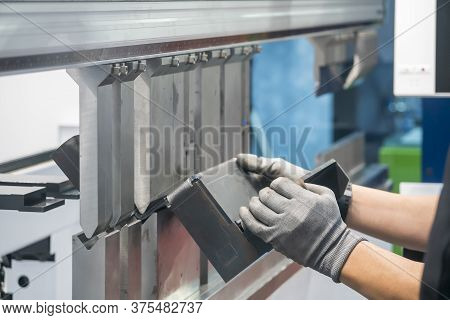 The Metalworking Operator Working With Hydraulic Bending Machine. The Automotive Sheet Metal Manufac
