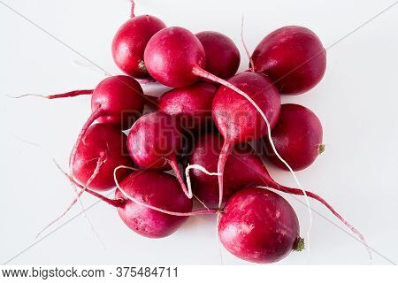 Red Radish With Root On A White Background. Close-up Of Red Radish With Root On A White Background.