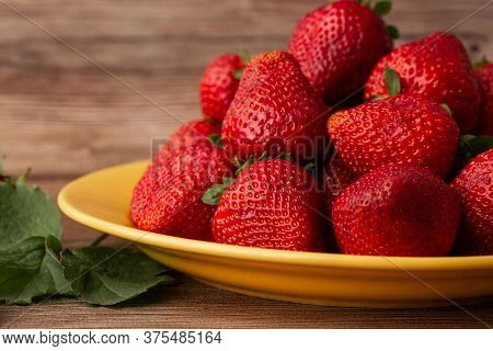 Fresh Strawberries In Plate On Wooden Table. Fresh Nice Strawberries. Strawberry Field On Fruit Farm