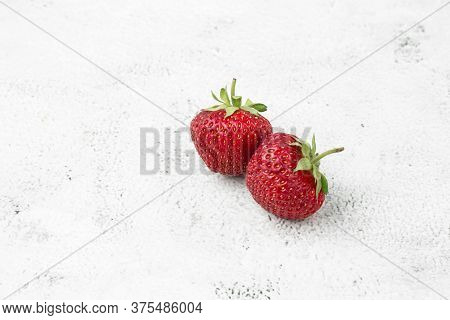 Fresh Ripe Perfect Strawberry On White Marble Background. Two Fresh Strawberry Isolated. Natural Foo