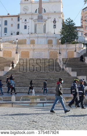 People Wearing Face Masks Cross The Spanish Steps Plaza, Rome, Italy