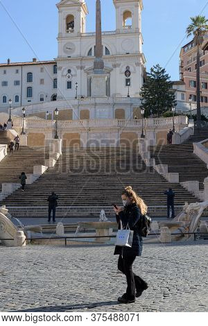 Woman With Face Mask Walks Across The Spanish Steps Plaza, Rome, Italy