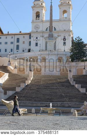 People Wearing Face Masks Cross Empty Squares In Front Of Monuments, Rome, Italy