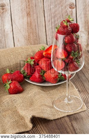 Fresh Strawberries In A Glass On Wooden Table. Fresh Nice Strawberries. Strawberry Field On Fruit Fa