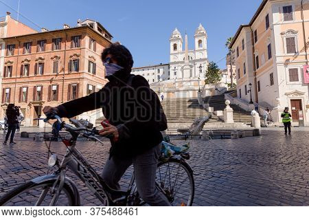 Woman On Bicycle At The Spanish Steps In Rome, Italy