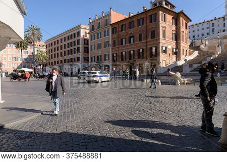 People Wearing Face Masks And Police Presence At The Spanish Steps, Rome, Italy