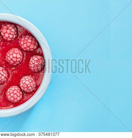 Cool Raspberry Berries Dessert, Sweet Raspberry Sorbet In A Blue Bowl On A Blue Background