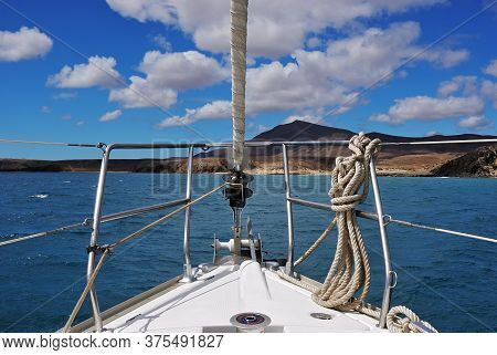 A Sailing Boat In The Atlantic Ocean. Lanzarote, Spain.  Canary Islands Archipelago