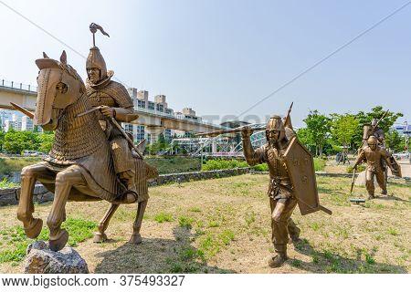 Gimhae, South Korea - June 18, 2017 : Replica Of Gaya Dynasty Soldiers Bronze Statue In Gimehae, Sou