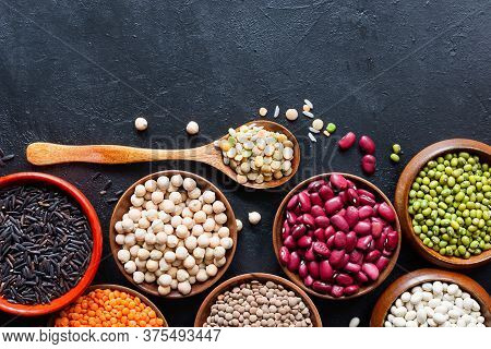 Legumes, Seeds And Cereals On A Dark Background. Healthy Food. Top View.