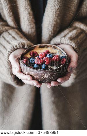 Healthy Vegan Breakfast Bowl With Oats In Womans Hands