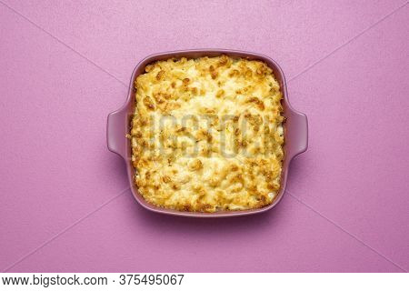 Top View With A Pink Tray With Mac And Cheese Baked With White Sauce. Freshly Baked Macaroni And Che