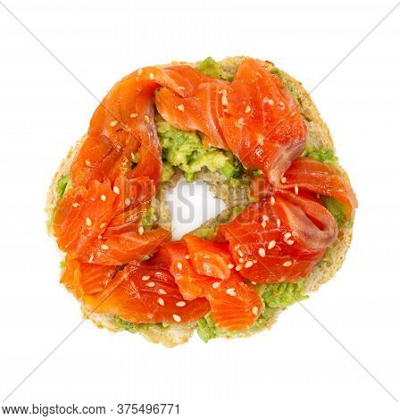Sliced Salmon With Avocado On Bagel With Sesame Seeds Isolated On White Background. Top View.