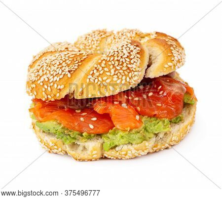 Sliced Salmon With Avocado On Bagel With Sesame Seeds Isolated On White Background.  Perfect Healthy