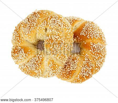 Two Turkish Bagels Simits With Sesame Seeds Isolated On White Background. Top View.