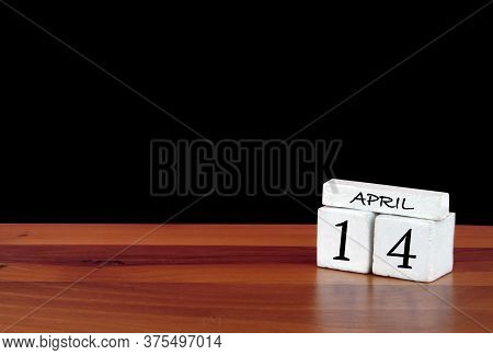 14 April Calendar Month. 14 Days Of The Month. Reflected Calendar On Wooden Floor With Black Backgro