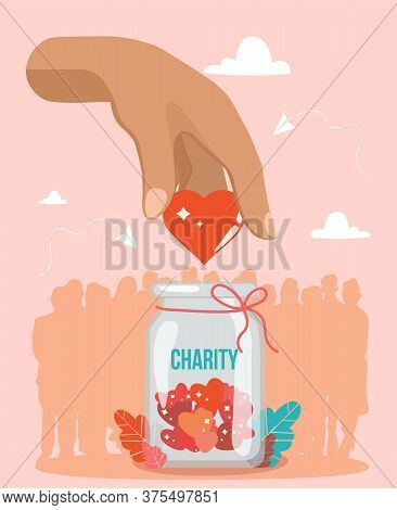 Support And Donations For Charity With A Hand Holding A Red Heart Above A Charity Jar For Donations
