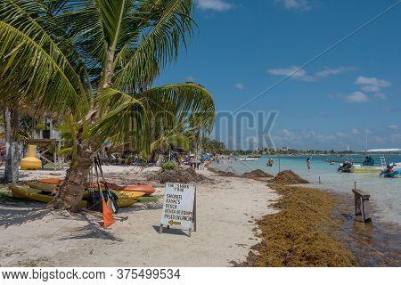 Tourists On The Mahahual Sandy Beach, Quintana Roo, Mexico