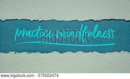 practice mindfulness - inspirational handwriting on a handmade rag paper, mindful lifestyle concept