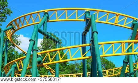 Roller Coaster Extreme Attraction In A City Park Close-up