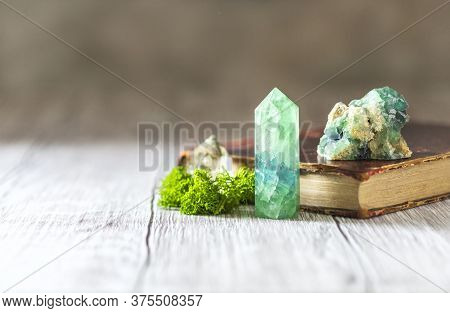 Old Book And Mineral Stones Crystals. Crystal Ritual, Healing Crystals. Natural Gemstones. Gemstones
