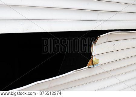 Broken Shutters On A Roller Shutter Window