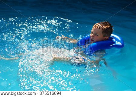 Happy Kid In Vest At Swimming Pool . Chilhood, Leisure, Swimming Theme. Boy In Life Jacket.