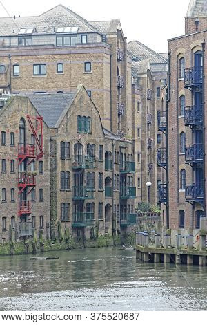 Converted Warehouse Buildings At Thames River Wharf In London
