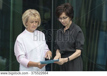 Strict Displeased Lady Boss Checking The Report Of A Subordinate Employee, Worker, Show What Needs T