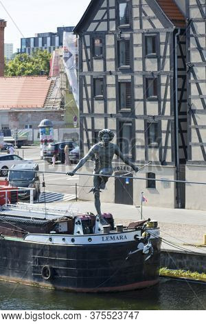Bydgoszcz, Poland - June 26, 2020: Crossing The River - A Balancing Sculpture Suspended On A Rope Ov
