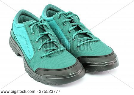 A Pair Of Cheap Aqua Mint Turquoise Green Hiking Shoes Isolated On White Background - Perspective Cl