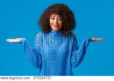 Who Cares I Dont Know. Confused And Clueless Silly Cute Smiling African-american Female In Winter Sw